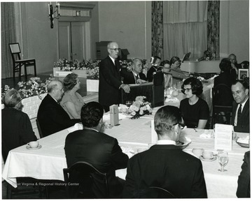 'Dr. Earl R. Boggs, WVU assistant to the President, introduces Dr. William C. Steere at Authors' Banquet of May 11, 1967.