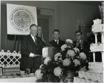 'WVU Birthday Dinner of Feb. 13, 1967, from left to right: Governor Smith; Thomas White, president of WVU Alumni Association; Dr. Harry B. Heflin, acting WVU president; and Jack Canfield, aide to Governor Smith.'