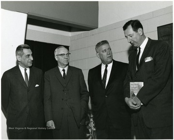 'Famed Kentucky author Jesse Stuart (second from right) chats with WVU professors John Caruso, prof. of history and chairman of the symposium planning committee (left); J.P. Brawner, prof. of English (second from left); and Ruel Foster, prof. and chairman of English (right) at the Feb. 22-24, 1967 'Lessons of History,' symposium.'