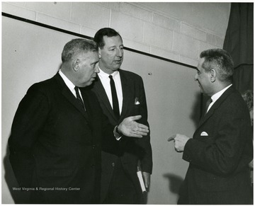 'Famous Kentucky writer Jesse Stuart (left) chats with WVU prof. Ruel Foster (Center) and planning committee chairman John Caruso (right) at 'Lessons of History' symposium Feb. 23, 1967.'
