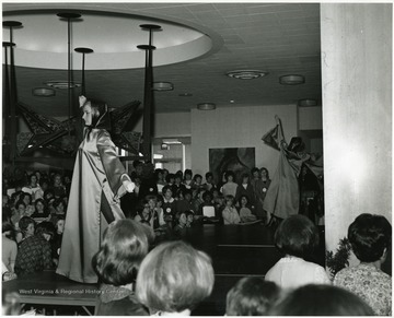 'Scene from the style show at the international meeting of the Association of Women Students, held Mar. 23-27, 1967 during the 100th Anniversary Observance.'