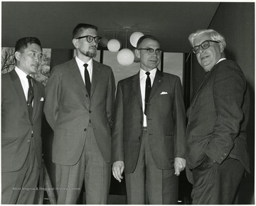 "'Dr. W. Gordon Whaley, University of Texas Graduate School (right), is shown with the WVU professors who served as panelists to react to his address at the Dec. 6, 1967 seminar on ""The Future of Graduate Education at WVU.""  Panelists include: Chin-Yung Wen, prof. of Chemical Engineering (left); Hugh Lindsay, prof. of Physiology (Second from left): and Homer Patrick, Prof. and chairman of Agricultural Biochemistry (second from right).'"