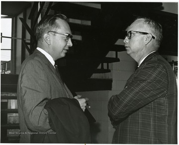 "'Donovan H. Bond, exec. dir. of the 100th Ann. Observance (right) chats with Harry Ernst, then Washington correspondent of the Charleston Gazette, at the June 29-29, 1967 ""Man and His Community"" symposium.'"