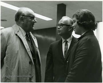 'Famed international figure Paul-Henry Spaak (left) chats with 100th Anniversary executive director Donovan H. Bond and his daughter Vicky before Spaak's Nov. 2 1967 address.'