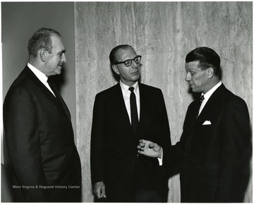 'Famed CBS correspondent Richard C. Hottelet (center) is shown chatting with WVU Acting President Harry B. Heflin (right) and Roman J. Verhaalen, Dean of the Kanawha Valley Graduate School (left) prior to Hottelet's Mar. 13, 1967 lecture on the International Emphasis Series.'
