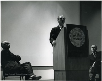 'Famed CBS correspondent Richard C. Hottelet is shown at the Mar. 13, 1967 International Emphasis Series Program.  Also shown are Donovan H. Bond, exec. dir. of the 100th Ann. observance (left), and Roman Verhaalen, Dean of the Kanawha Valley Graduate Center (right).'