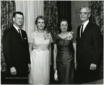 'Acting WVU President Harry B. Heflin (left), Mrs. Heflin (second from left), Dr. Irvin Stewart (right), and Mrs. Stewart are pictured just after Dr. Stewart made the main address as spokesman for the twelve professors honored at the Faculty Honors Convocation Mar. 7, 1967.'