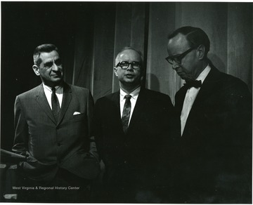 'Noted historian Arthur Schlesinger (right) chats with planning committee chairman John Caruso (left) and 100th Ann. Exec. director Donovan H. Bond (center) at Lessons of History symposium Feb. 22, 1967.'