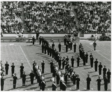WVU marching band performs on the field on a game day.