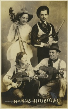 Four country musicians holding their instruments - guitars, upright bass, and violin (fiddle).