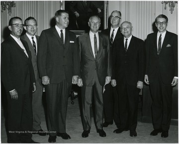 Gov. Smith in center, and second from left, Neil Bolyard
