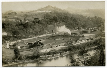 A view of Morgantown: Mississippi Glass factory along the Monongahela River; the Dorsey Knob in the distance.