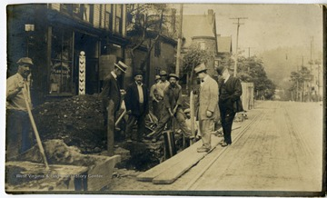 Several men are engaging in road construction.