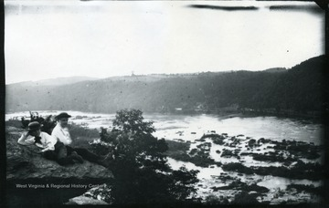 A photograph of two young boys on the left with a river below. '137.W.(58); August 2, 1884, Saturday 6 pm.'