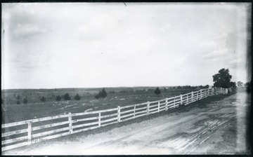 'End of Sheridan's famous ride to battlefield of Cedar Creek looking North. The ridge on the left where the whole fenced cemetery stand was held for a while by our troops and then they were forced back parallel with the pike beyond Middletown, a few houses of which are seen on the right. At the first of them, on the right of the pike. Walter drew water from a well out in the field for the team. (62)D.101; July 30, 1884, Wednesday 12:45 pm'