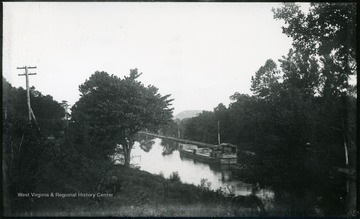 A photograph of a boat floating down a canal. '184.D(109); Aug. 8, Fri. 5:35 p.m.'