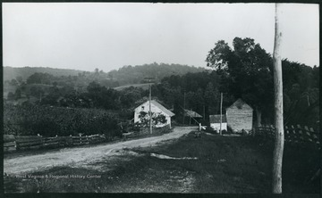 A photograph of a country road with two small buildings standing on either side. '108 D.; Friday Aug. 8, 1884, 5 p.m.'