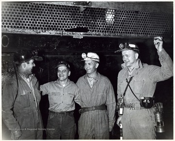 A photograph of Senator Hoblitzell, Jr. standing with a group of miners.