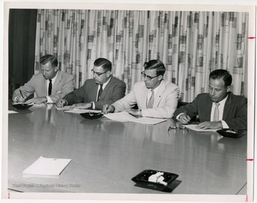Left to right, Benjamin W. Skeen, secretary-treasurer of the State Federation; Eugene A. Carter, unidentified, unidentified.