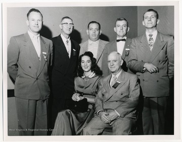 Standing left to right : Guy Hoffman (6th District), William J. Staddon (2nd District), James Q. Papas (4th District), Allen Hudkins (4th District), Rene Zabeau (3rd District). Seated: Ruth Ann White (5th District), C.V. Baumann (1st District).