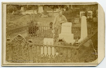 "Jubal Early, former Confederate General, leans against General Thomas ""Stonewall"" Jackson's headstone in the ""Stonewall Jackson Memorial Cemetery"". Early served under Jackson in the Army of Northern Virginia during the Civil War. Jackson's remains were reinterred in 1890, several feet from the original grave site. A large statue of Jackson was placed over the new grave."