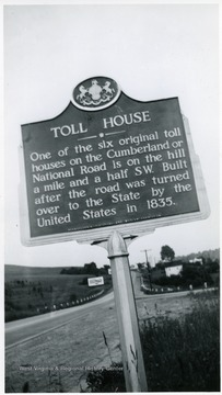 'One of the six original toll houses on the Cumberland or National Road is on the hill a mile and a half SW. Built after the road was turned over to the State by the United States in 1835.'