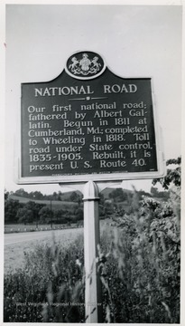 'Our first national road; fathered by Albert Gallatin. Begun in 1811 at Cumberland, Md.; completed to Wheeling in 1818. Toll road under State control, 1835-1905. Rebuilt, it is present U.S. Route 40.'