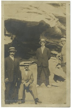 Great Uncle Lawrence Pietro, Thoney Pietro, Lawrence Pietro, and Henry Pietro standing in front of rock caves in Williamson, W.Va. Back of postcard reads' Morgantown family who came to Morgantown in 1904. All Italian intermarriages except one Belgian woman.'