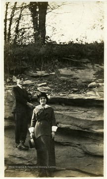 Lawrence and Rose Pietro standing in front of large rock formation.