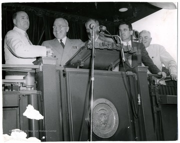 From left to right: M. M. Neely, Harry S. Truman, Unknown, Clarence Meadows, Harley Kilgore.