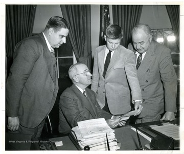From left to right, Eugene A. Carter, President H. S. Truman, Unknown and Senator Sam Ervin.
