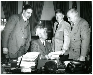 From left to right: Eugene A. Carter, President Truman, Unknown and Senator Sam Ervin.