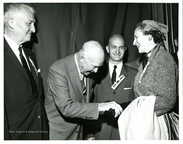 From left to right: Senator Chapman Revercomb, President Dwight Eisenhower, Senator John D. Hoblitzell, Jr. and Unknown.