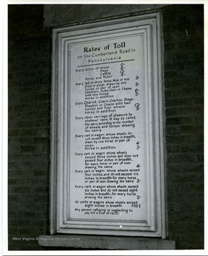 Shown here is a plaque showing the toll rates in front window at Searights Toll House.