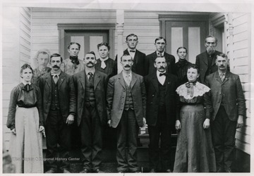 'Back row: John; Stella; Carrie; Blaine; Henry; Mother; Father*. Front Row: Nettie Harman; Job; Albert: Samson, Jr.; Elmer; Phebe; Dow. * - Captain and Mrs. Sampson Snyder.'