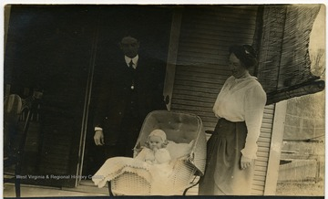 ' Otto and Calora with their daughter Cornelia at six months. She sat alone at 5 and half months old. '