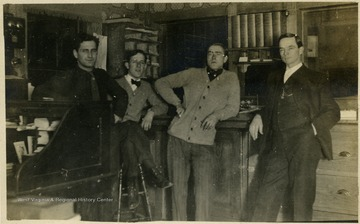 Dr. Otto Ladwig (right) at the Raine-Andrews Lumber Company.
