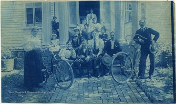 Man and woman with bicycles stand on each side of the group.