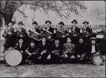 A group portrait of musicians posed holding their instruments.