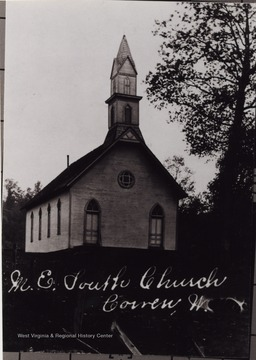 "The Church is located ""where road leads to town park."""