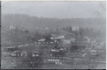 """Notice the roof of the depot, it is different than present depot, the town burned on May 30, 1911 the night of the first graduating class, the building on the top left is the hospital, later dorms, later grade school, later Brinson furniture, to the far right on hill is wooden high school before brick building built."""