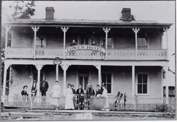 "Group portrait in front of the hotel. The Cowen Hotel was located ""opposite of the Depot and below present-day Minnichs Florist."""