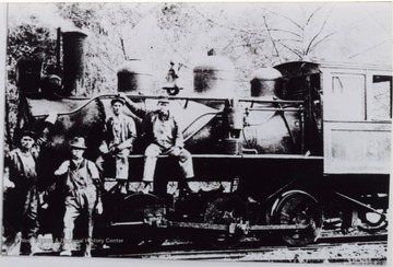Crew is posed in front of the locomotive.