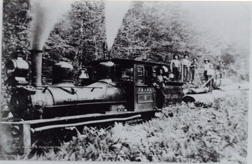 Crew is posed behind the locomotive.