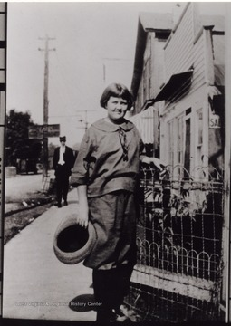 """Lady is a Hyatt, in front where Callahan's Grocery was before the town burned in early 1930's."""