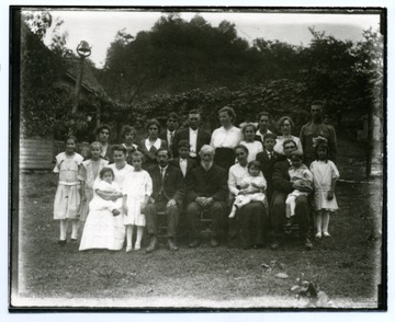 Back Row: Alma Ramsey, Mable Ramsey, Ruth Ramsey, Edwin Ramsey, Alfred Teuscher, Mary Isch Teuscher, Ida Sutton, Bill Sutton, Anna Sutton, Harley Sutton. Front Row: Alma Teuscher, Lena Teuscher, Anna Marti Teuscher, Margaret Teuscher, Gertrude Teuscher, Jacob Tuescher, Francis Sutton, John Teuscher, Bertha Teuscher Sutton, Mable Sutton, David Sutton, George Sutton, Edward Sutton, Elda Sutton.