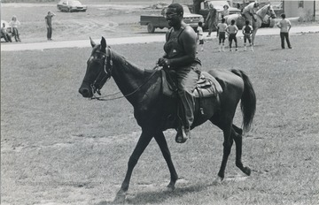 Ed Cabbell riding a horse during the John Henry Folk Festival in Charleston, W.Va.