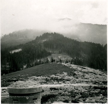 "Photograph taken by United States Army Major Elmer Prince of Morgantown, W. Va. Note the German ""pillbox"" in the foreground used to the defend Hitler's Eagle Nest."