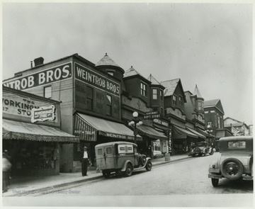 Pleasant Street lined with businesses, such as Weintrob Brothers, Glassman's and Peoples Market.