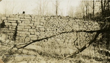 A dam for a flour mill, made out of split stone on Deckers Creek, near Pioneers Rocks in Monongalia County.